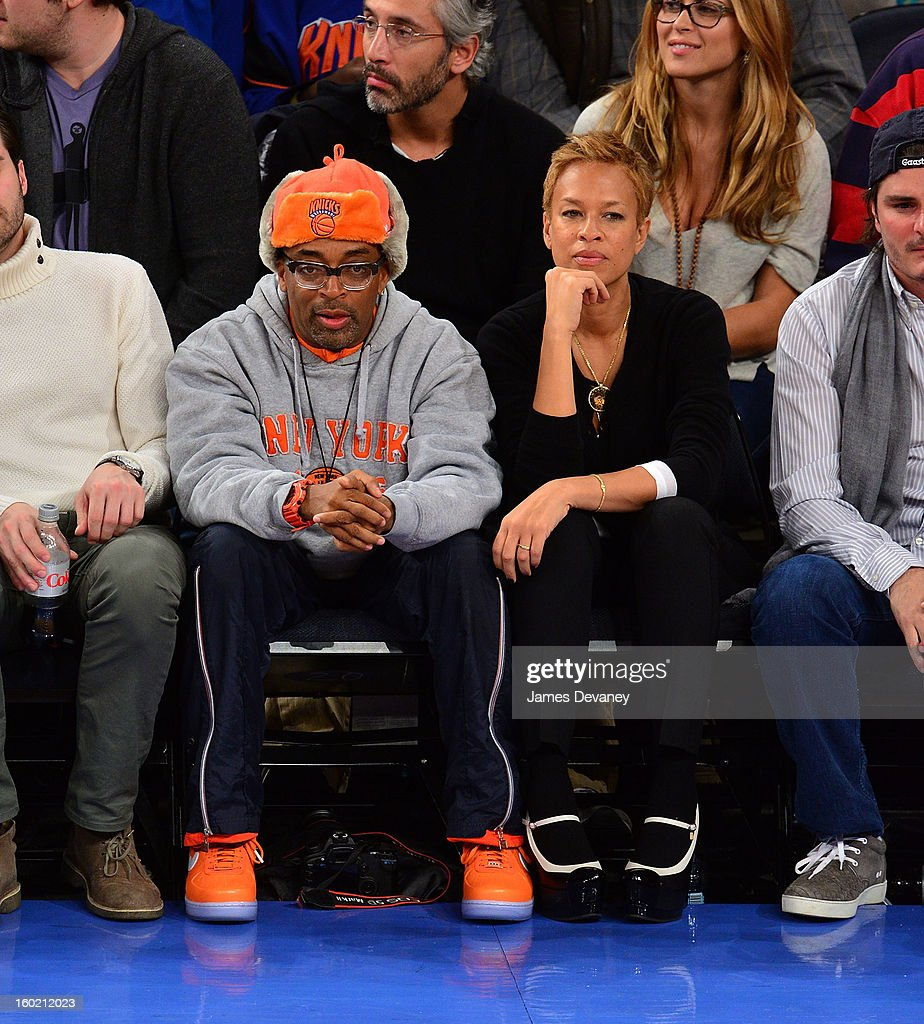 Spike Lee and Tonya Lewis Lee attend the Atlanta Hawks vs New York Knicks game at Madison Square Garden on January 27, 2013 in New York City.