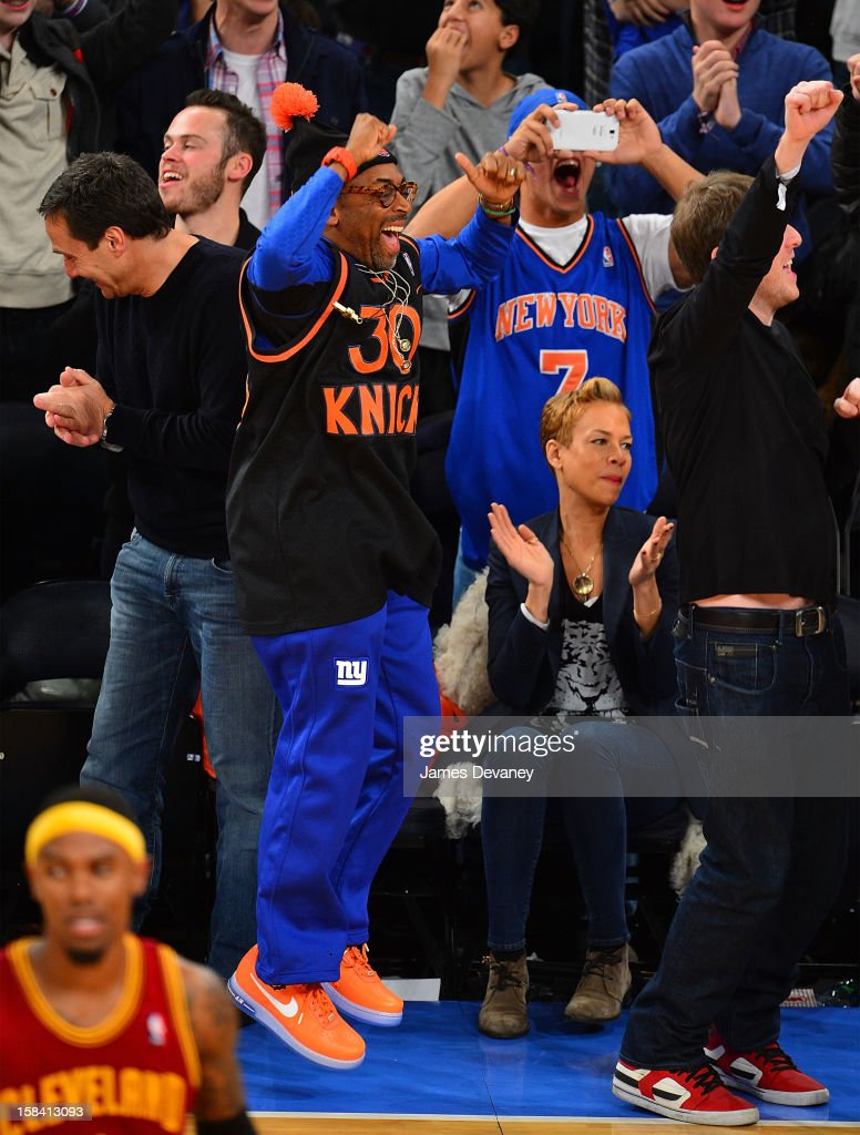 Spike Lee and Tonya Lewis Lee attend the Cleveland Cavaliers vs New York Knicks game at Madison Square Garden on December 15, 2012 in New York City.