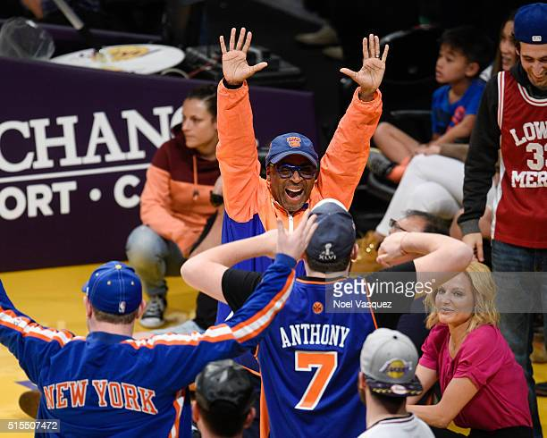 Spike Lee celebrates at basketball game between the New York Knicks and the Los Angeles Lakers at Staples Center on March 13 2016 in Los Angeles...