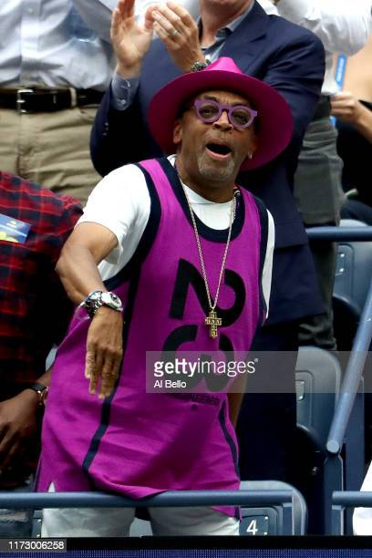 Spike Lee, director and producer, celebrates a point during the Women's Singles final match between Serena Williams of the United States and Bianca...