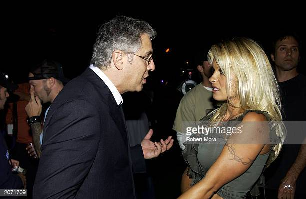Spike TV President Albie Hecht and actress Pamela Anderson socialize at the official launch party for Spike TV at the Playboy Mansion on June 10 2003...