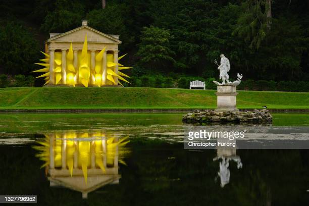 Spiked, an inflatable art installation, by Steve Messam, bursts through the columns of the Temple of Piety, at Studley Royal on July 09, 2021 in...