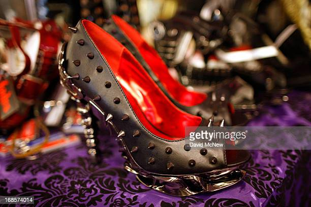 Spiked fetish shoes are displayed for sale in the exhibit hall of the domination convention DomConLA in the evening hours of May 10 2013 in Los...