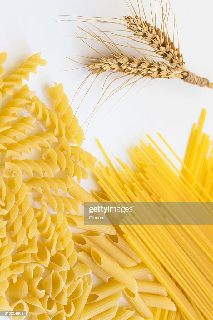 Spikelets of wheat and several types of pasta : Stock Photo