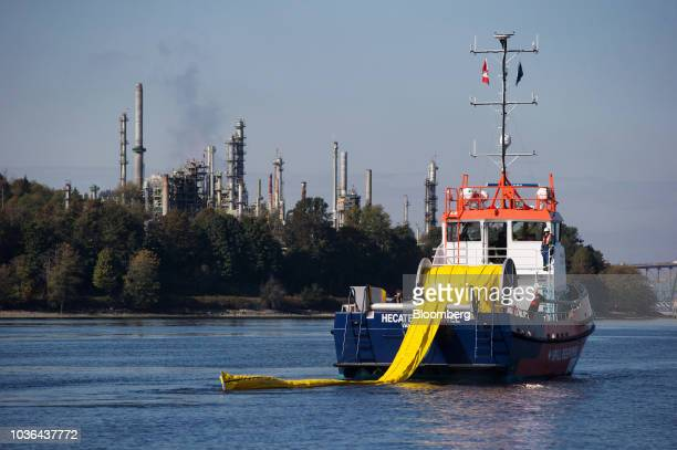 Oil storage tanks sit at the Kinder Morgan Inc Westridge Marine Terminal during an emergency response exercise in Burnaby British Columbia Canada on...