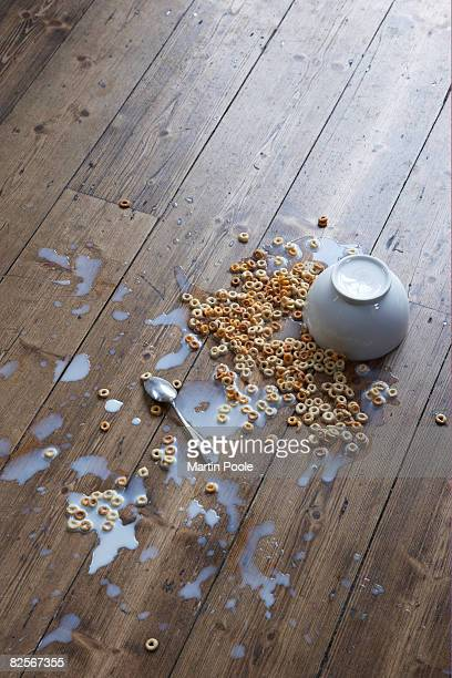 spilled breakfast cereal on floor - flooring stock photos and pictures