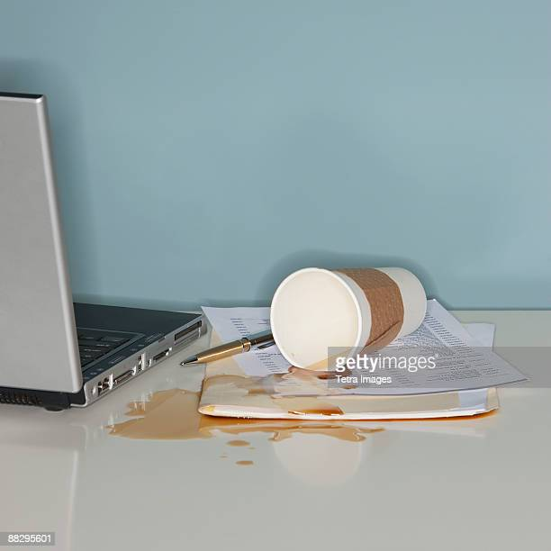 Spilled coffee on office paperwork
