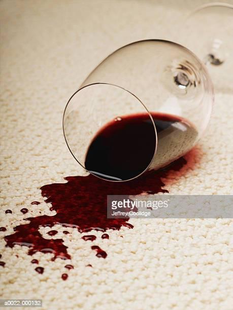 spilled glass of red wine - wine stain stockfoto's en -beelden