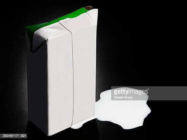 spilled milk from carton - milk carton stock photos and pictures