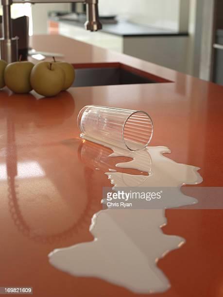 Spilled milk on kitchen counter