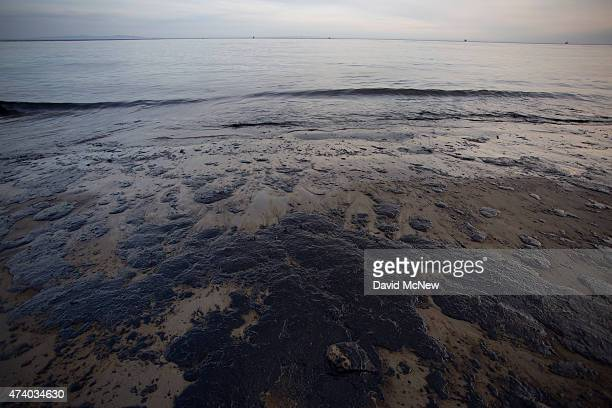 Spilled oil covers the beach at Refugio State Beach as the Channel Islands are seen in the distance on May 19 2015 north of Goleta California About...