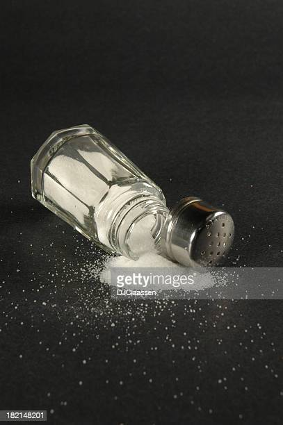 spilled salt - sodium stock photos and pictures