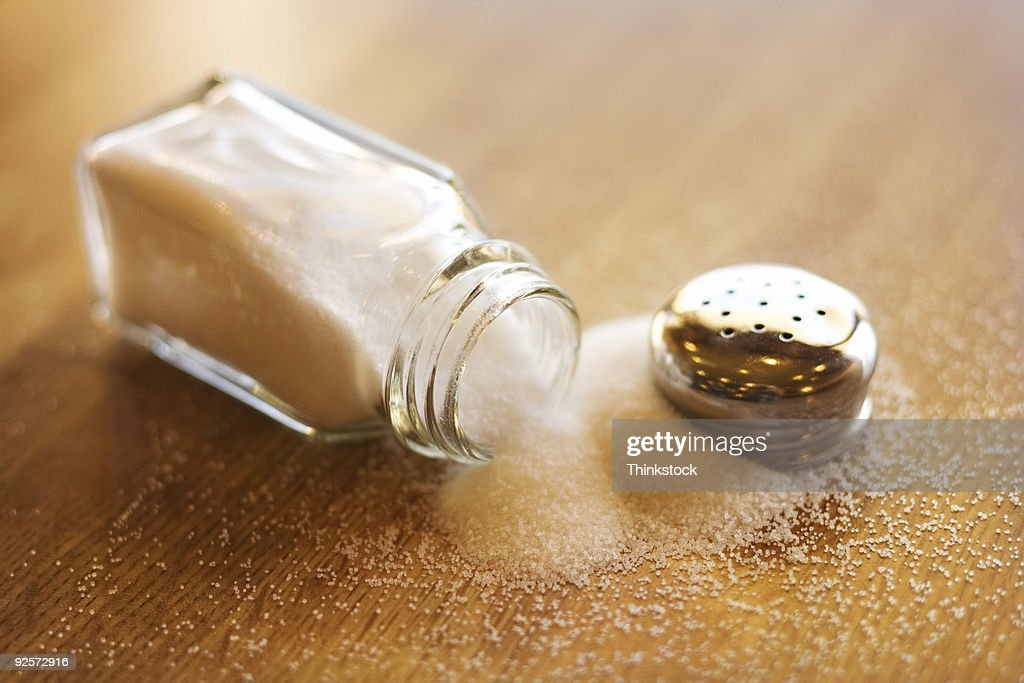 Spilled salt shaker : Stock Photo