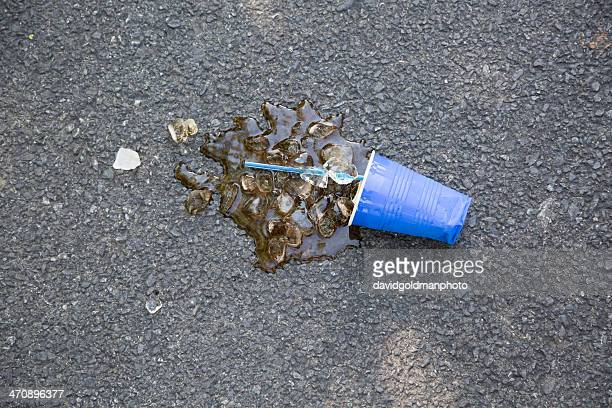 spilled soft drink with plastic cup and ice cubes on tarmac - chatham new york state stock pictures, royalty-free photos & images