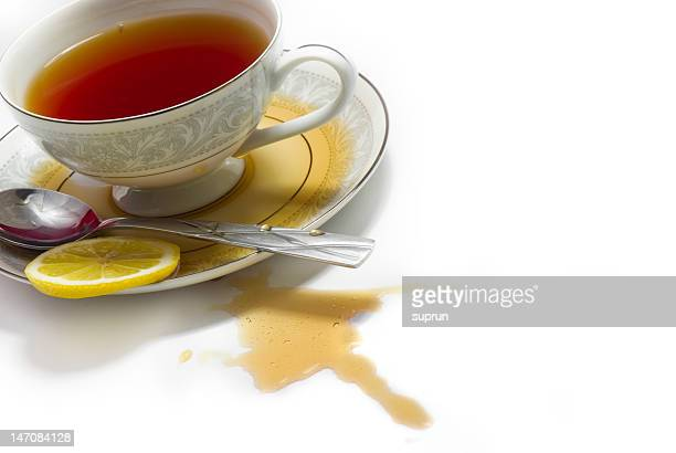 spilled tea - saucer stock pictures, royalty-free photos & images