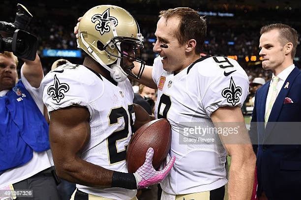 J Spiller hands the touchdown ball to Drew Brees of the New Orleans Saints during overtime against the Dallas Cowboys at the MercedesBenz Superdome...