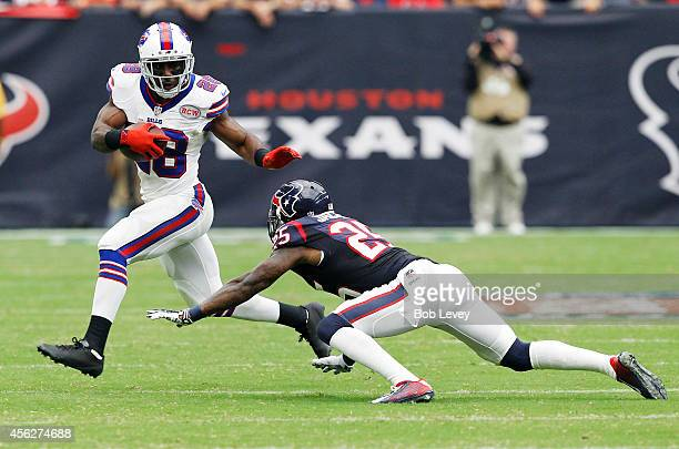 J Spiller of the Buffalo Bills avoids the tackle of Kareem Jackson of the Houston Texans in the second quarter in a NFL game on September 28 2014 at...