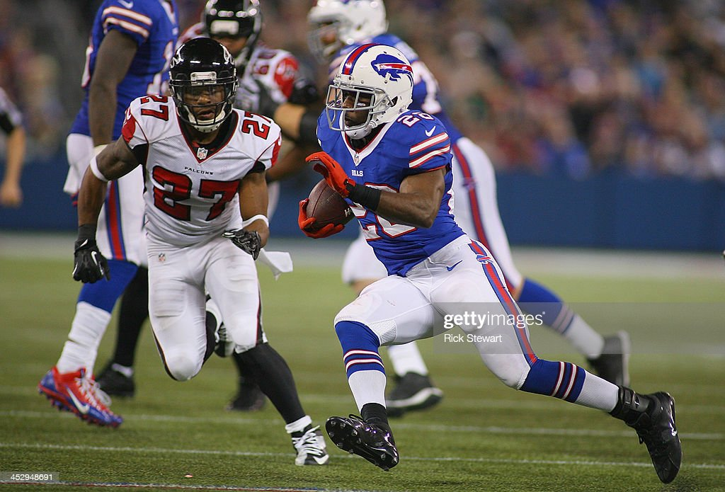 C.J. Spiller #28 of the Buffalo Bills runs for a 36 yard touchdown in the fourth quarter against Robert McClain #27 of the Atlanta Falcons at Rogers Centre on December 1, 2013 in Toronto, Ontario.Atlanta won 34-31 in overtime.