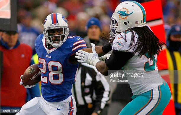 J Spiller of the Buffalo Bills runsa against Dannell Ellerbe of the Miami Dolphins at Ralph Wilson Stadium on December 22 2013 in Orchard Park New...