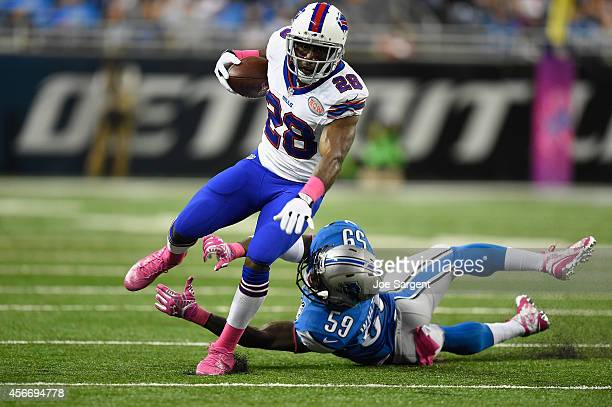 J Spiller of the Buffalo Bills tries to avoid the tackle by Tahir Whitehead of the Detroit Lions in the third quarter at Ford Field on October 05...