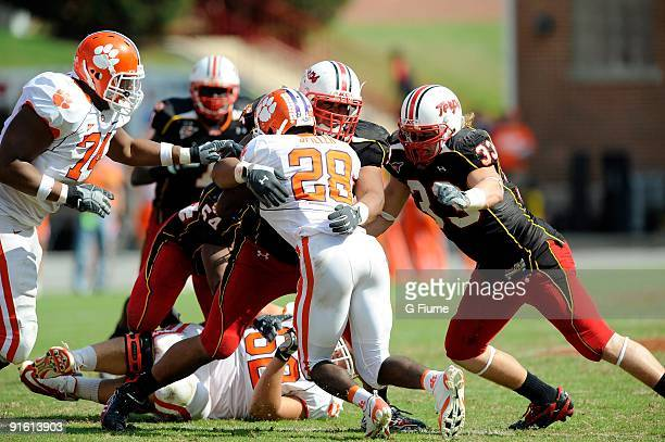 J Spiller of the Clemson Tigers is tackled by AJ Francis and Alex Wujciak of the Maryland Terrapins at Byrd Stadium on October 3 2009 in College Park...