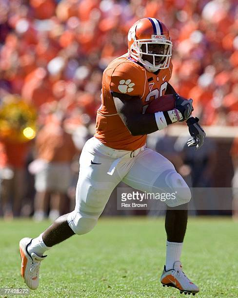 J Spiller of the Clemson Tigers picks up a first down on this run against the Central Michigan Chippewas at Memorial Stadium on October 20 2007 in...