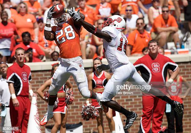 J Spiller of the Clemson Tigers pulls down this pass for a touchdown as he is defended by JC Neal of the North Carolina State Wolfpack during the...