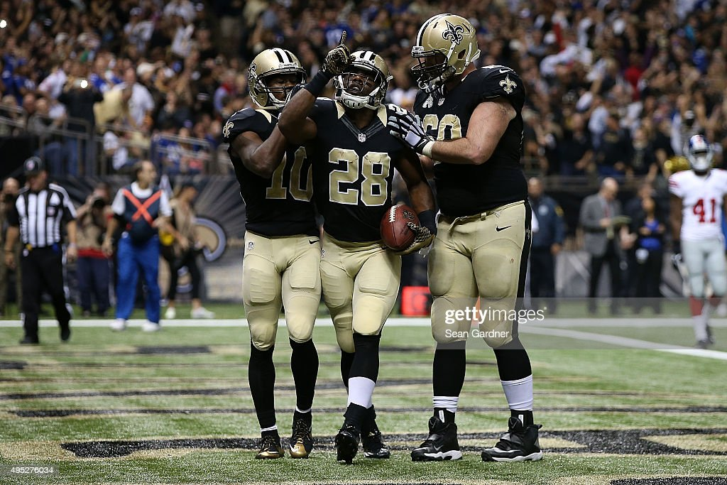 C.J. Spiller #28 of the New Orleans Saints celebrates a touchdown with teammates following a late touchdown against the New York Giants at the Mercedes-Benz Superdome on November 1, 2015 in New Orleans, Louisiana.