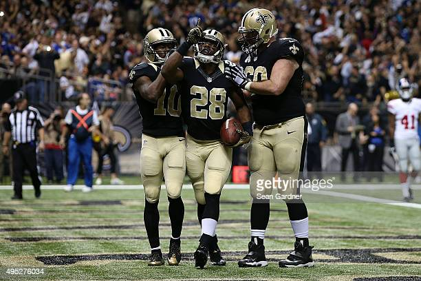 J Spiller of the New Orleans Saints celebrates a touchdown with teammates following a late touchdown against the New York Giants at the MercedesBenz...