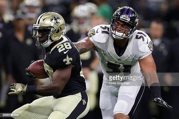 J Spiller of the New Orleans Saints is tackled by Kamalei Correa of the Baltimore Ravens at the MercedesBenz Superdome on September 1 2016 in New...