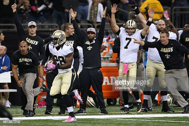 J Spiller of the New Orleans Saints runs for a touchdown to defeat the Dallas Cowboys 2620 in overtime at MercedesBenz Superdome on October 4 2015 in...