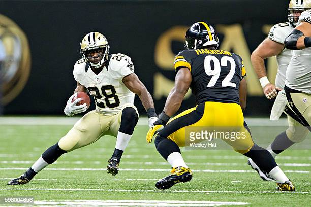 J Spiller of the New Orleans Saints runs the ball against James Harrison of the Pittsburgh Steelers during a preseason game at MercedesBenz Superdome...