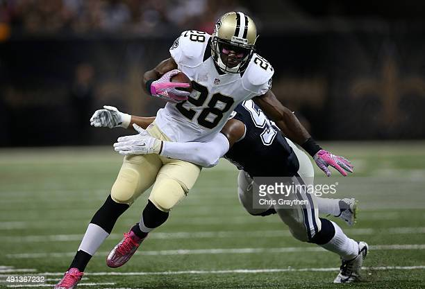 J Spiller of the New Orleans Saints runs the ball for a first down during the fourth quarter against the Dallas Cowboys at MercedesBenz Superdome on...