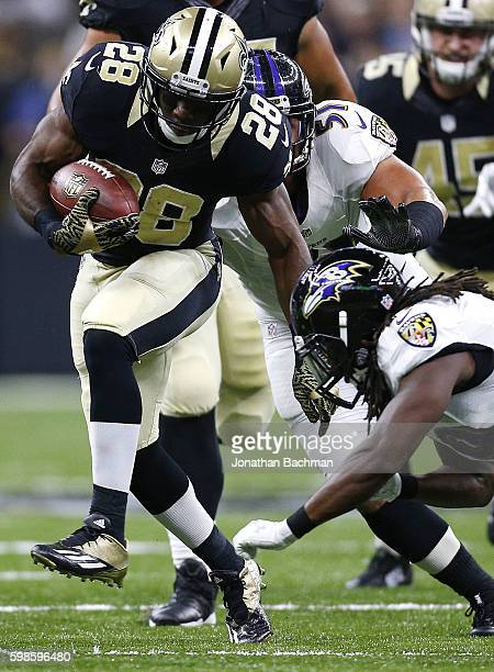 J Spiller of the New Orleans Saints runs with the ball during the first half of a preseason game against the Baltimore Ravens at MercedesBenz...