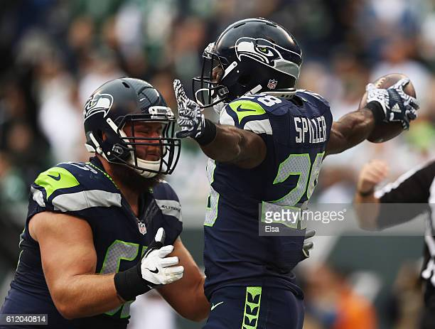 J Spiller of the Seattle Seahawks celebrates his touchdown with teammate Joey Hunt against the New York Jets in the second quarter at MetLife Stadium...