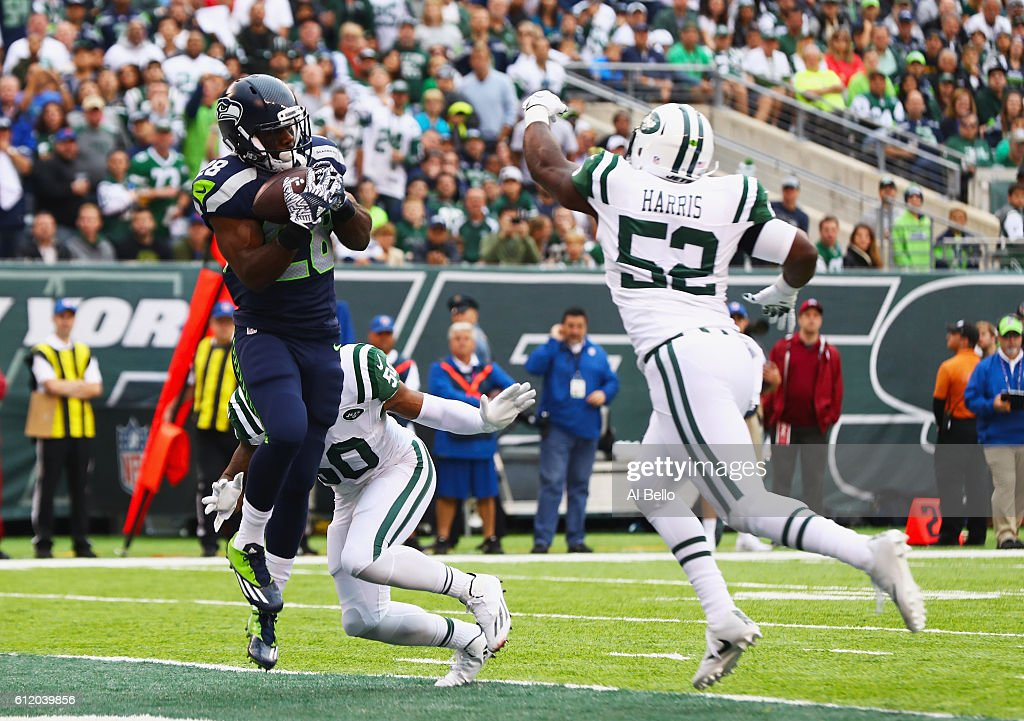 C.J. Spiller #28 of the Seattle Seahawks scores a touchdown against Darron Lee #50 and David Harris #52 of the New York Jets in the second quarter at MetLife Stadium on October 2, 2016 in East Rutherford, New Jersey.
