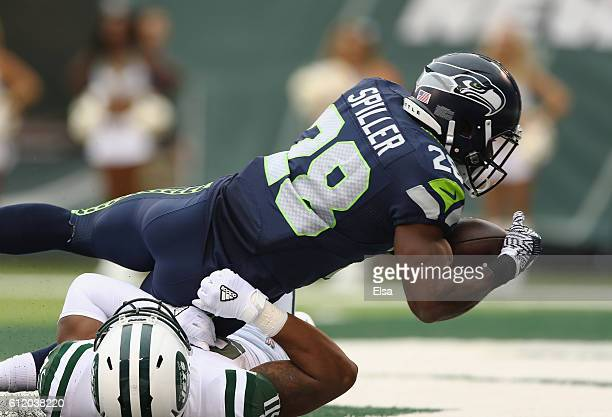 J Spiller of the Seattle Seahawks scores a touchdown against the New York Jets in the second quarter at MetLife Stadium on October 2 2016 in East...