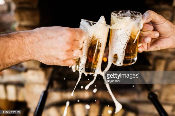 spilling beer during a toast! - honour stock pictures, royalty-free photos & images