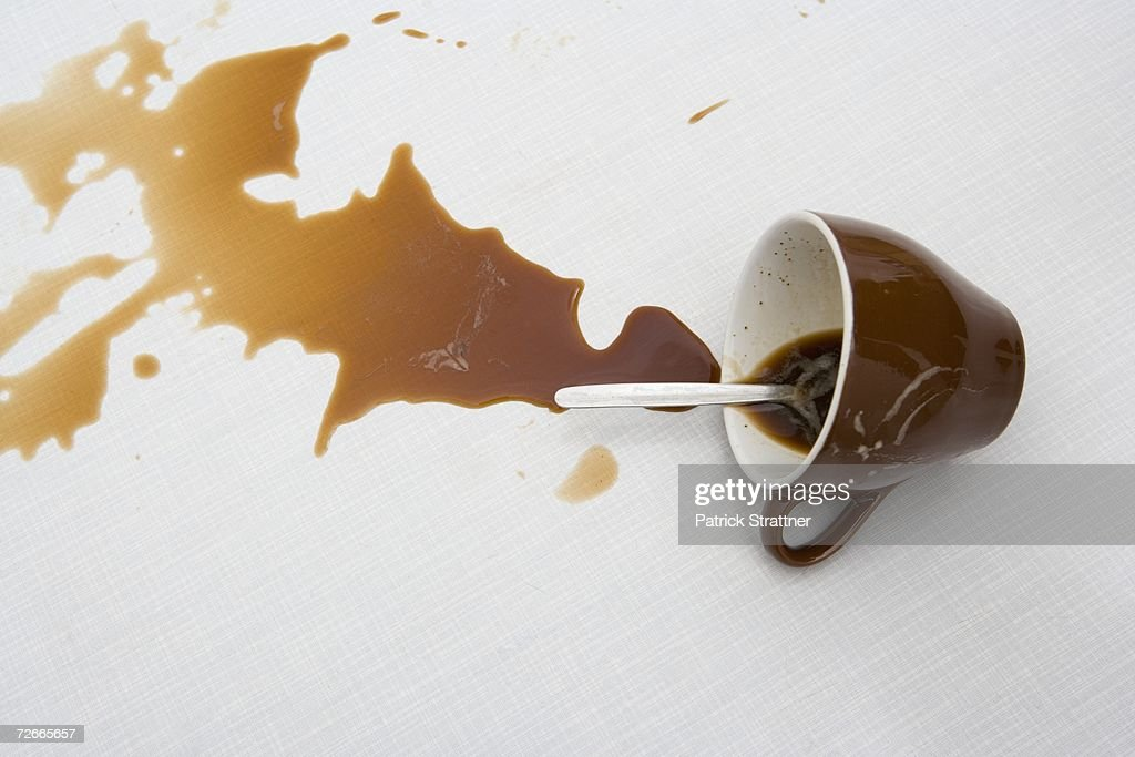 Spilt cup of coffee : Stock Photo