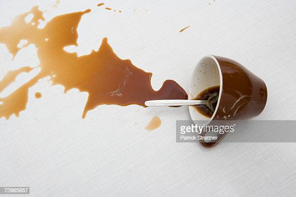 spilt cup of coffee - dump stock photos and pictures