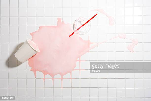 spilt strawberry shake on tiled floor - spilling stock pictures, royalty-free photos & images