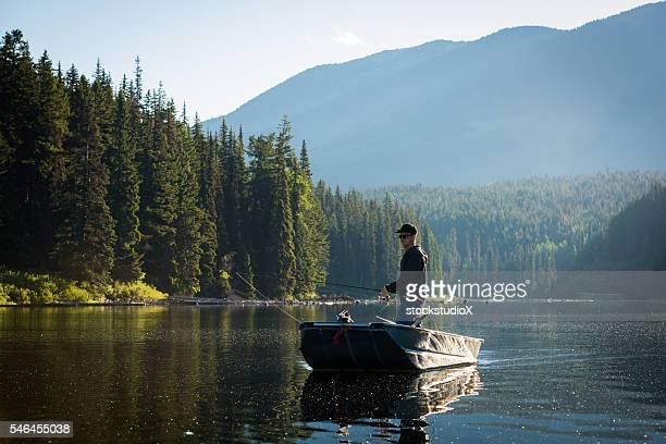 spin fishing - commercial_fishing stock pictures, royalty-free photos & images