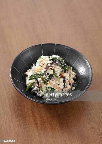 spinach dressed with mashed tofu - konjac foto e immagini stock