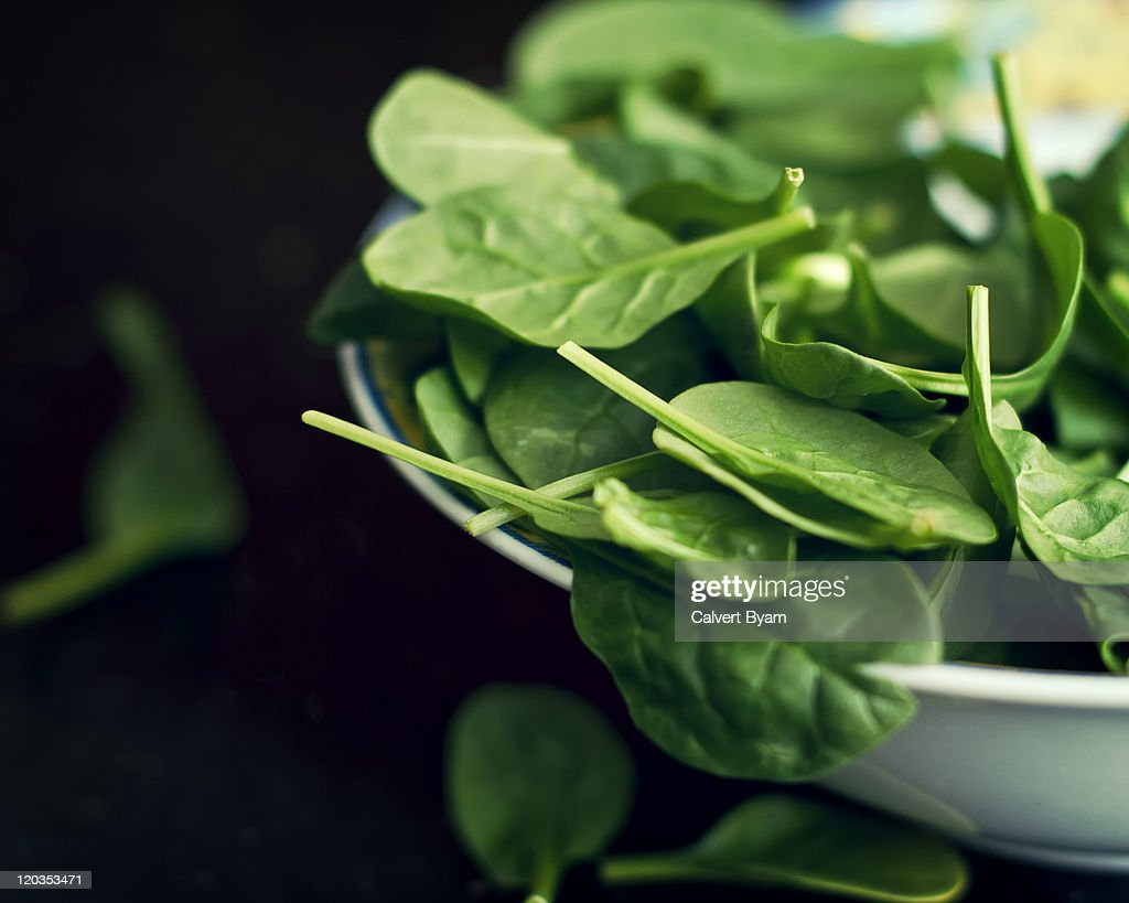 Spinach salad in bowl : Stock Photo