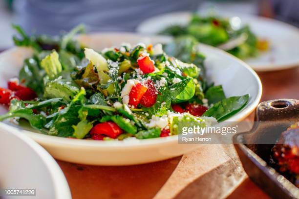 spinach salad with strawberries, goat cheese, balsamic, and walnuts - spinach stock pictures, royalty-free photos & images