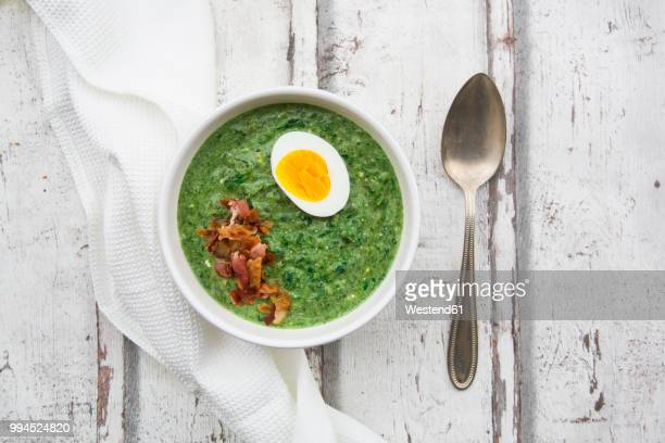 spinach soup with egg and bacon - green eggs and ham stock photos and pictures
