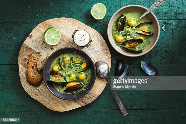 spinach soup with green olives and vermouth mussels - mussel stock pictures, royalty-free photos & images