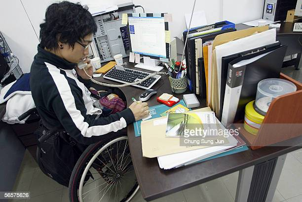 Spinal cord injury patient, Lee Seung-Il, works in his office on January 12, 2006 in Seoul, South Korea. More than 130,000 spinal cord injury...