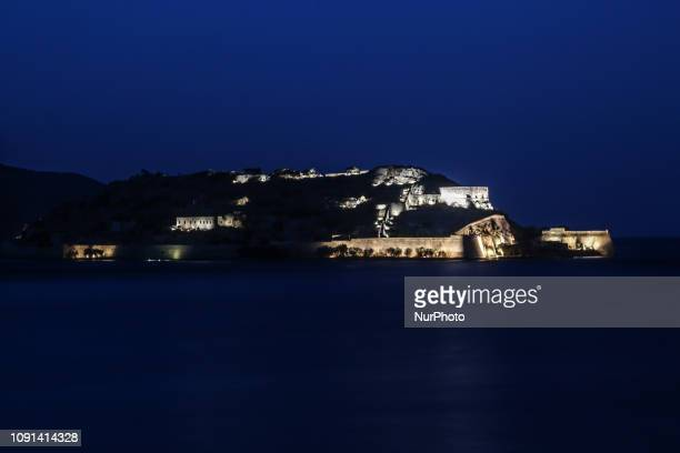 Spinalonga island illuminated after the sunset in the Gulf of Elounda in Crete island in Lasithi regional unit Spinaloga was a leper colony from 1903...