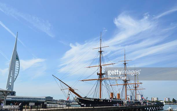 spinnaker tower and hms warrior - spinnaker tower stock photos and pictures